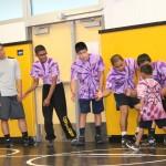 wrestling purple coaches hi five